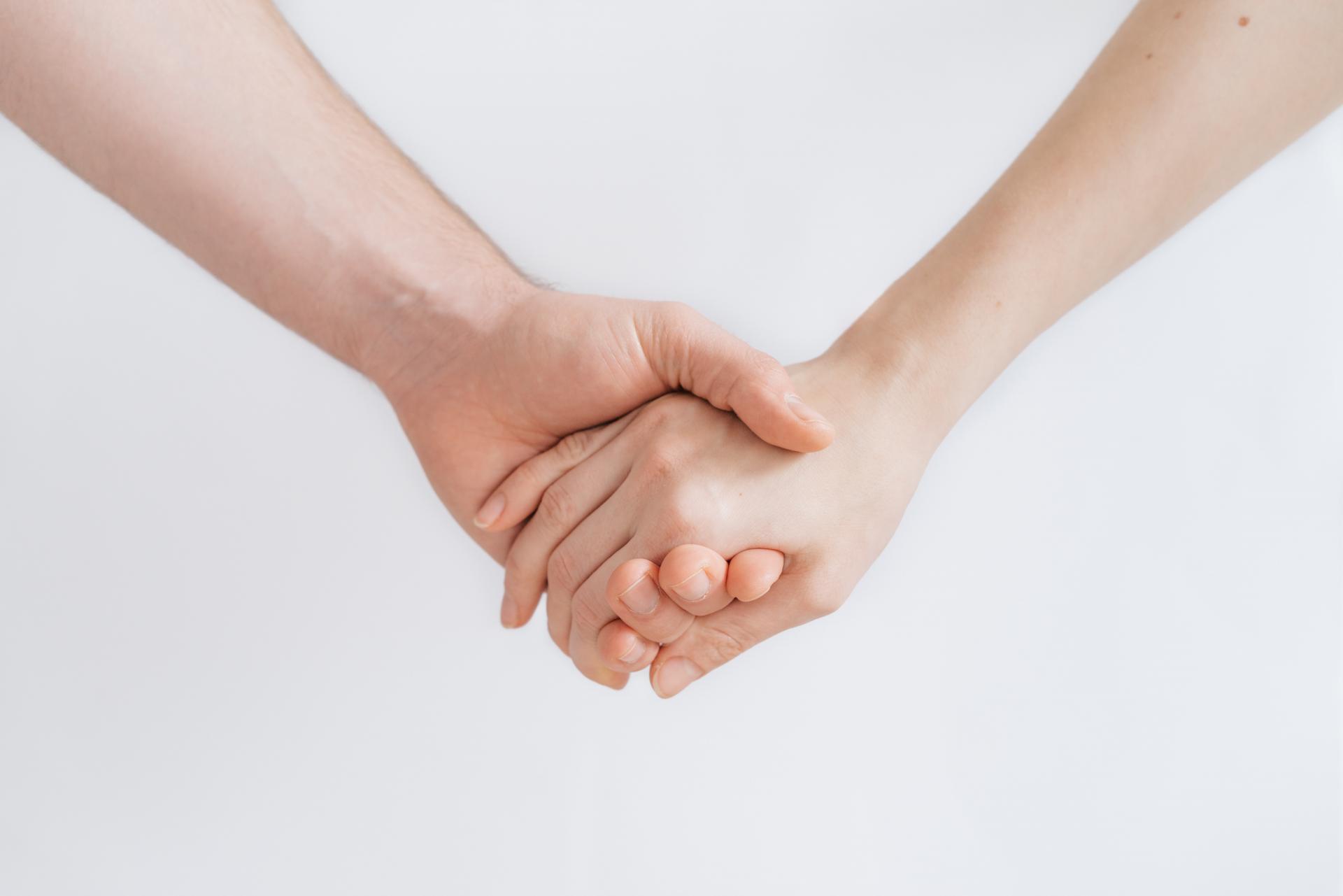 Handen vast